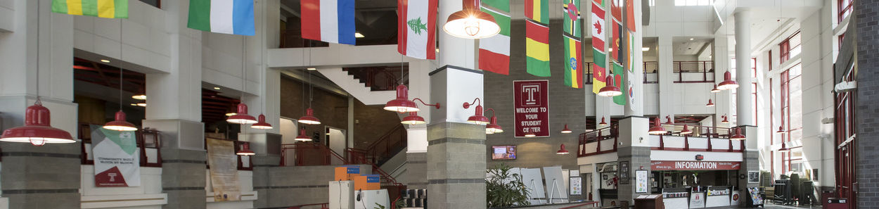 Photo of lobby of Student Center with flags.